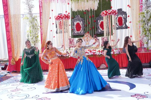 indian bride dancing with bridesmaids | Surprise Proposal