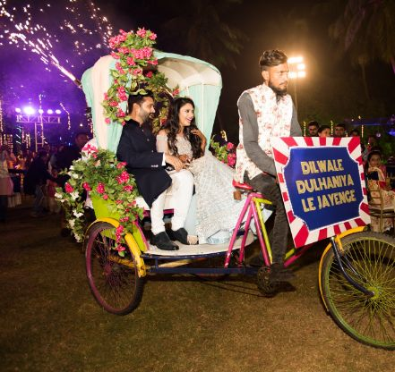 couple entry at sangeet ceremony | destination wedding in Daman
