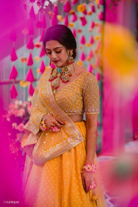 candid capture of the bride at mehendi ceremony