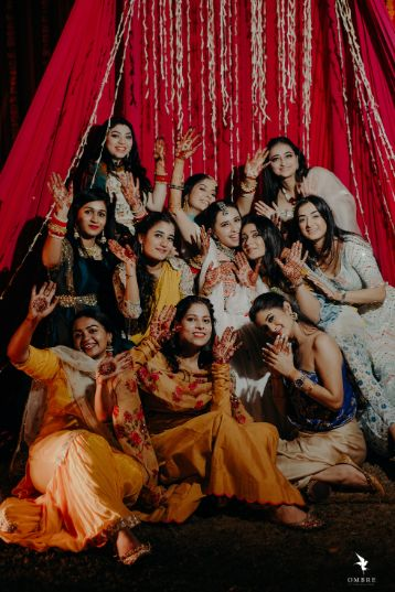 photo with bridesmaids at sangeet ceremony