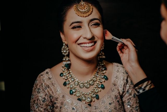 Indian bride getting ready photos |Rimple & Harpreet Wedding Lehenga