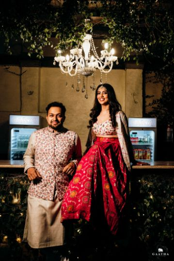 indian couple photography ideas | bride pink skirt and crop top