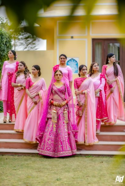 indian bride posing with bridesmaids | Fab Matching Outfit Ideas