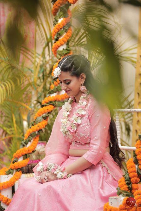 indian bride in pink lehenga for her mehendi ceremony | Modern Customised Lehenga Embroidery