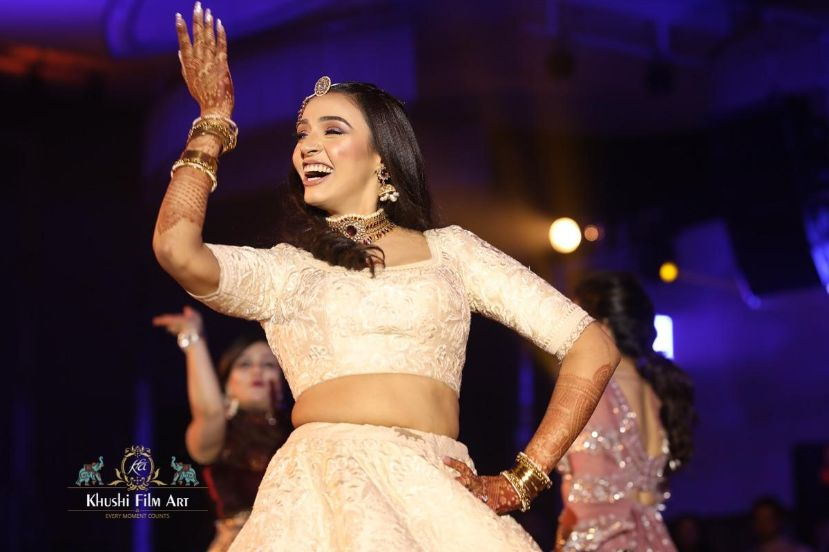 indian bride dancing on sangeet night