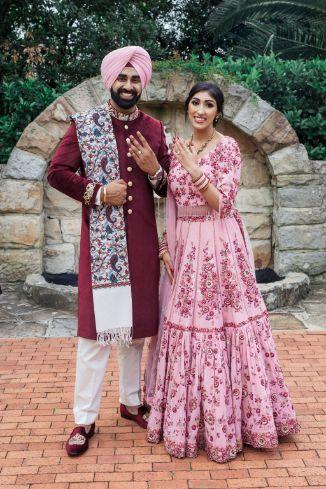 bride in baby pink lehenga   groom in msroon sherwani