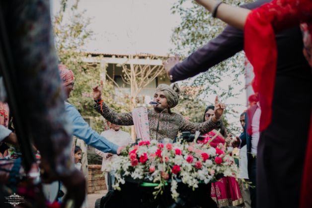 indian groom entering on ATV | Stunning Colourful Wedding Lehenga