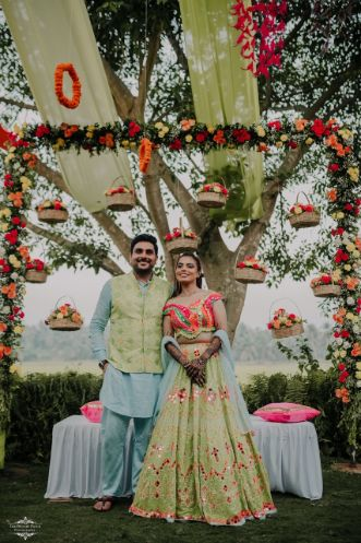 stunning mehendi day decor | couple in matching outfits