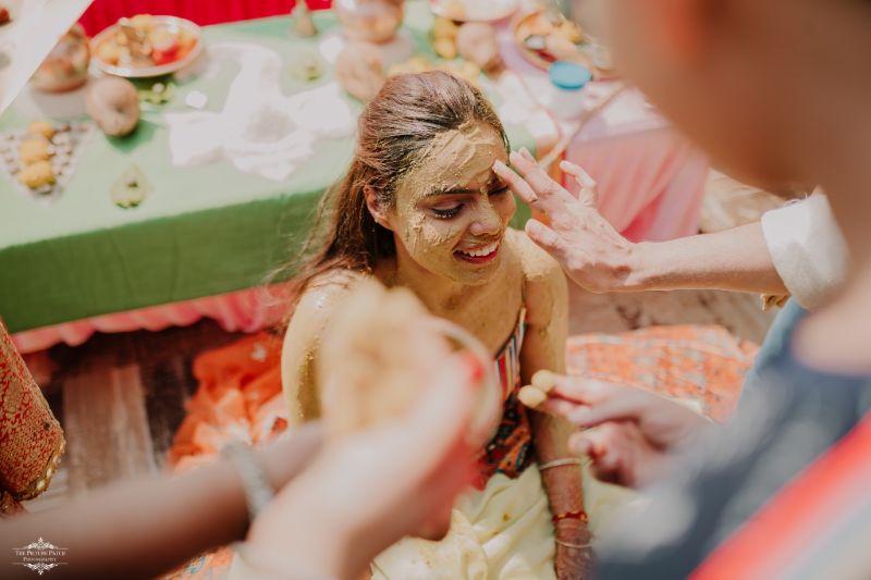 relatives applying haldi to the bride