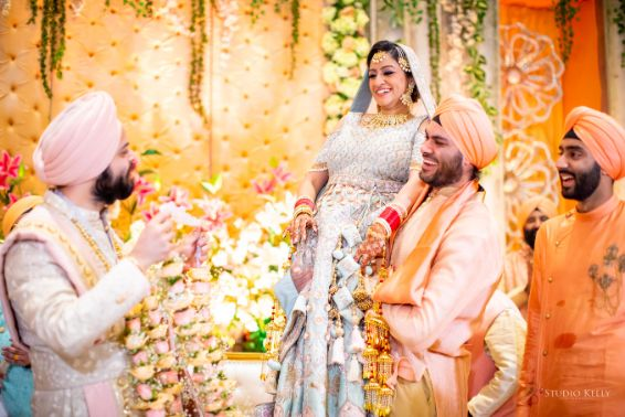 varmala ceremony | sikh wedding | Pastel Wedding with a Stunning Reception Look