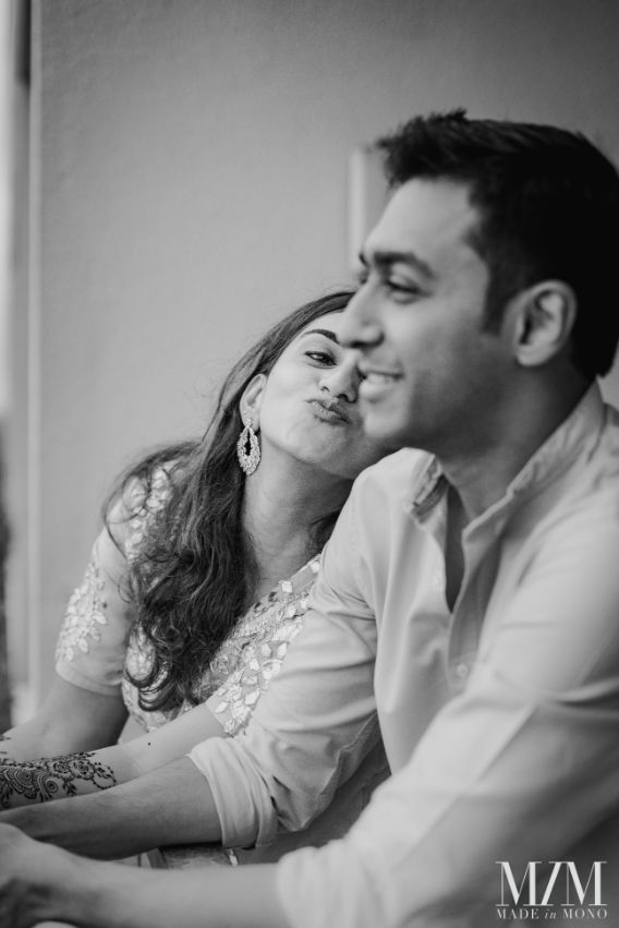 cute couple candid photo from mehendi ceremony
