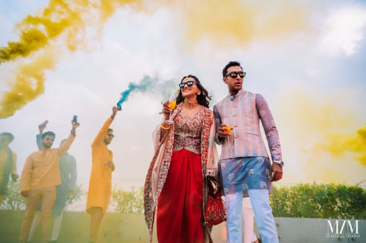 bride and groom entry on mehendi day | color bomb ideas