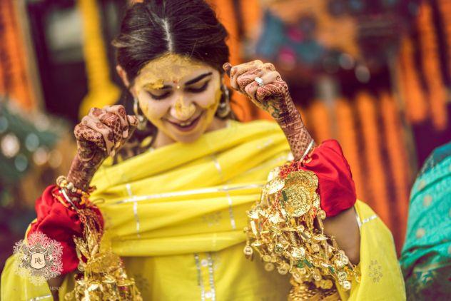 indian bride immersed in haldi | Mirror Work Lehenga for Mehendi