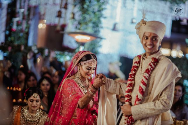 hand in hand | indian couple | Gorgeous Sabyasachi Lehenga in Pink - Delhi Wedding