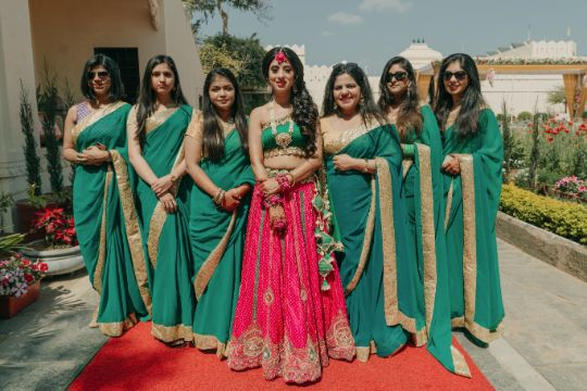 bridesmaids in matching outfits