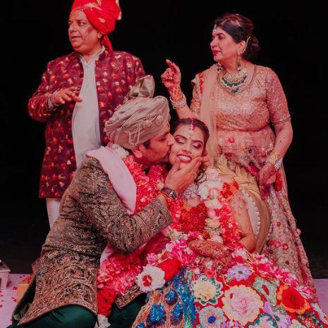 sealing it with a kiss | indian couple at mandap | Stunning Colourful Wedding Lehenga - Beautiful Goa Wedding