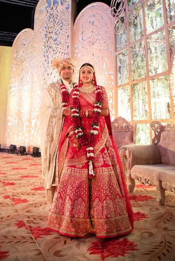 indian couple post varmala photos | stunning outfit for the brode and groom