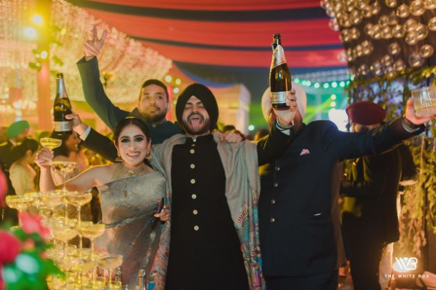 indian groom grooving reception day | Sabyasachi Saree in Gold Sequins
