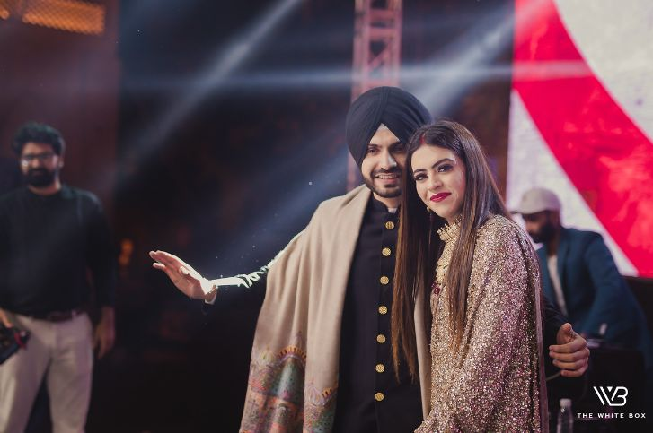 candid photo from an indian wedding | Sabyasachi Saree in Gold Sequins