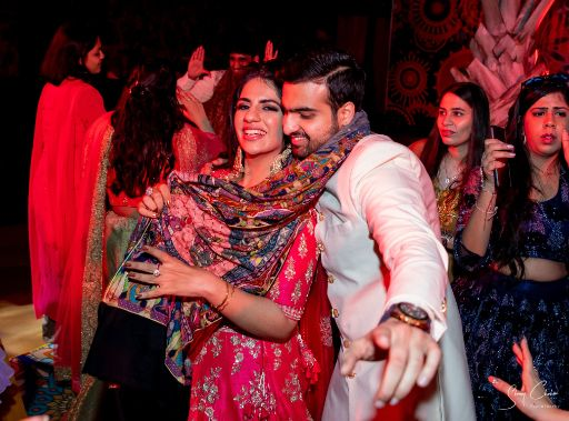 couple enjoying at their sangeet ceremony