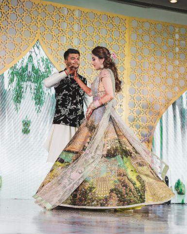 couple dance ideas | decor golas | Printed Lehenga  & a Gorgeous Off Shoulder Blouse - Megnha & Devansh
