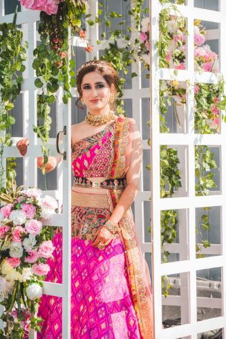 stunning pink bridal outfit for mehendi ceremony | Printed Lehenga  & a Gorgeous Off Shoulder Blouse - Megnha & Devansh