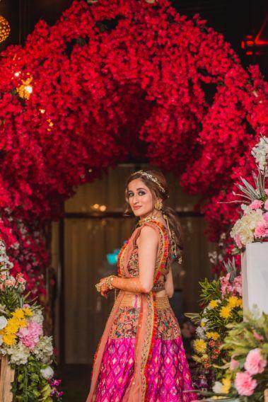 red decor   decor goals   mehendi function   poses for photos   Printed Lehenga  & a Gorgeous Off Shoulder Blouse - Megnha & Devansh