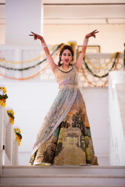 indian bride dancing on sangeet night | Printed Lehenga  & a Gorgeous Off Shoulder Blouse - Megnha & Devansh