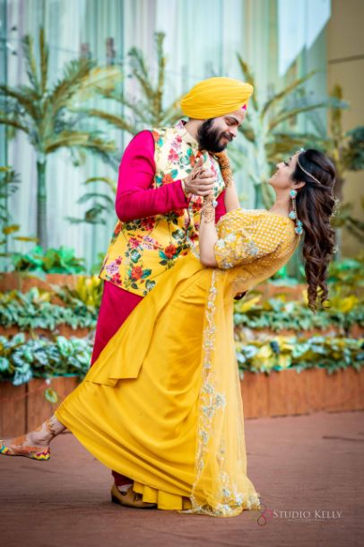 bride in stunning yellow outfit for mehendi day