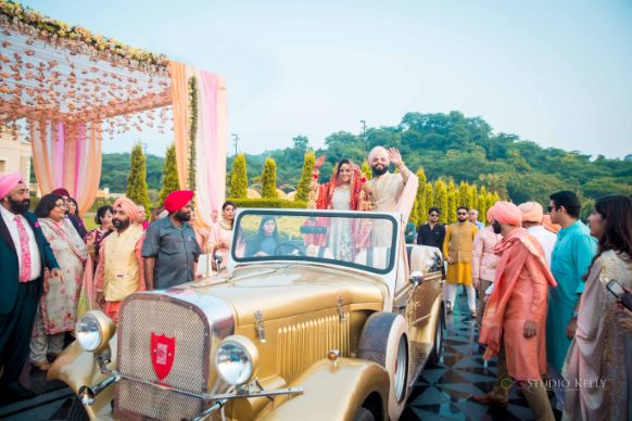 groom entry ideas in a jeep | Pastel Wedding with a Stunning Reception Look