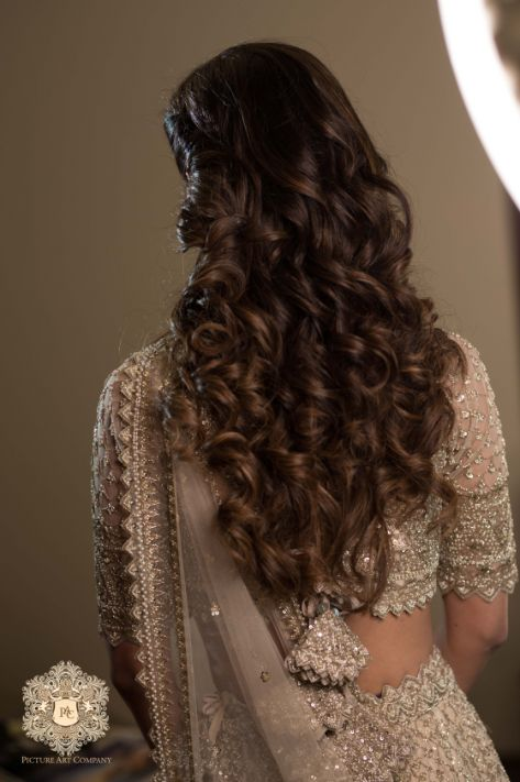 curly hairstyle ideas for engagement day | Mirror Work Lehenga for Mehendi
