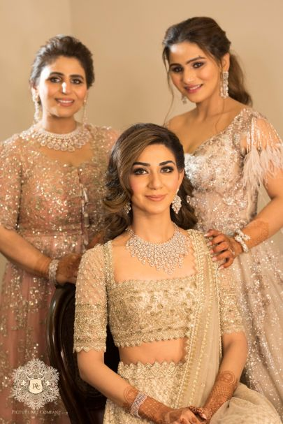 portraits with mother and sister of the bride | Mirror Work Lehenga for Mehendi