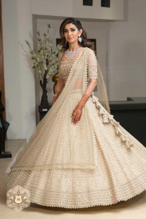 engagement outfit   stunning ivory lehenga   Mirror Work Lehenga for Mehendi