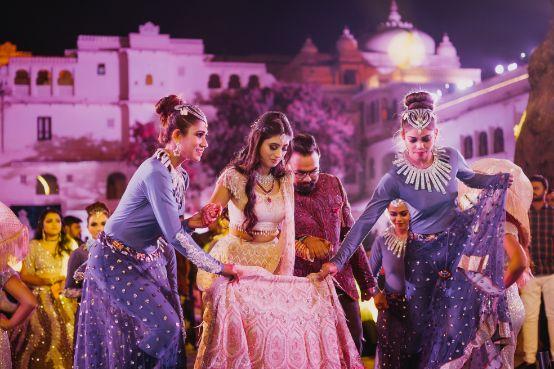 bride entering on her sangeet ceremony day | Destination Wedding in Udaipur