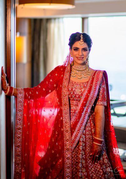 indian bride in traditional red lehenga | Anita Dongre Wedding Lehenga