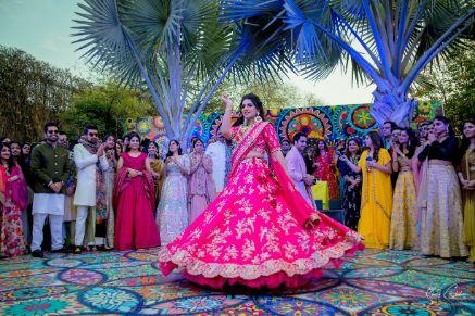 twirling bride in pink lehehnga