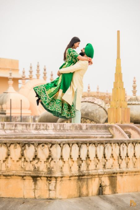 indian couple poses for pre and post wedding photo shoot