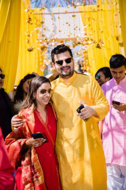 bride in red groom in yellow kurts | haldi ceremony