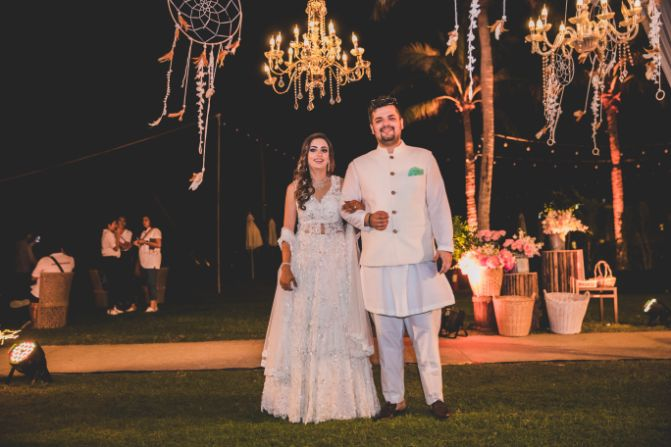 couple in white outfit for mehendi function