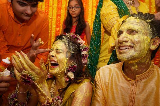happy bride | candid capture in haldi ceremony