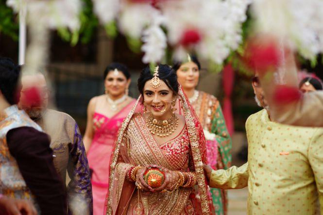 indian bridal entering her wedding day   Prettiest Mumbai Wedding