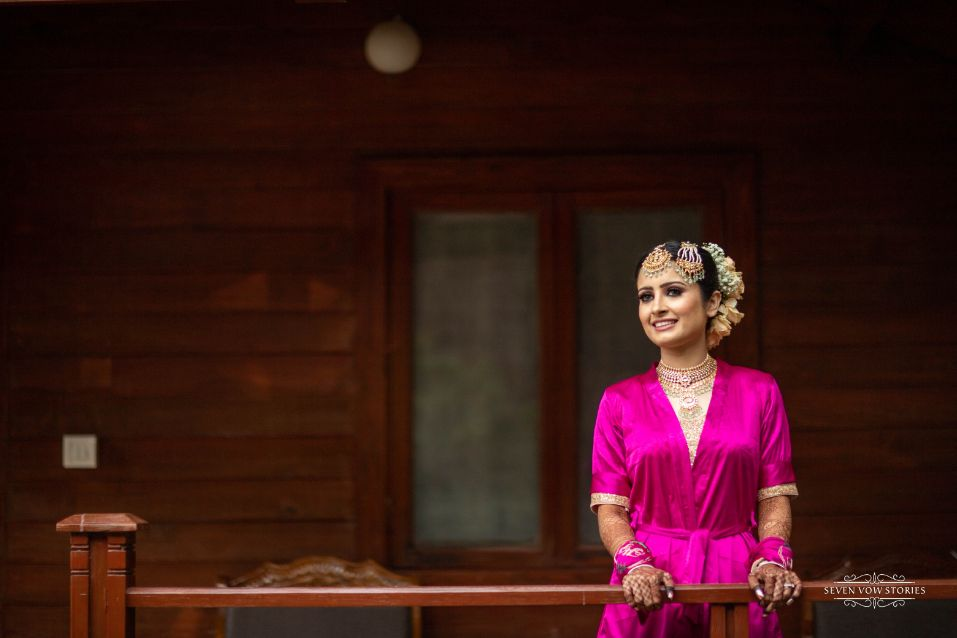 bride in pink robe   indian brides getting ready photos
