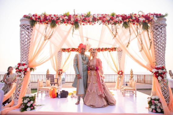 beautiful pink mandap setting | indian couple on their wedding day