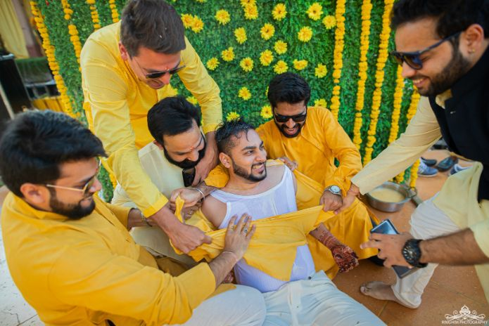 groomsmen indian groomsmen halid scene | indian groom | Destination wedding in jodhpur | indian wedding | colourful lehenga | halid shot | haldi shower | indian bride | wittyvows | #haldi #weddings #indianwedding #yellow #lehenga | Quirky Mehendi function