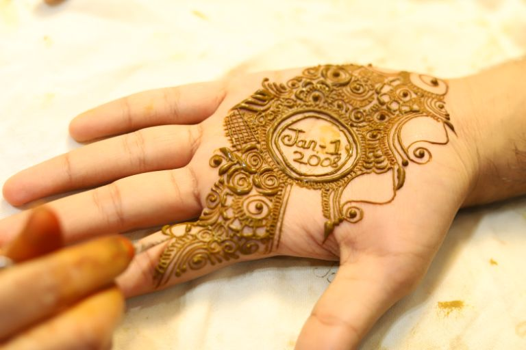groom henna stained hands