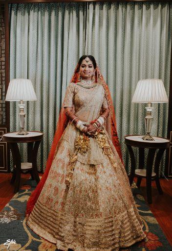 stunning golden lehenag for the bride   Wedding at Ramoji Film City