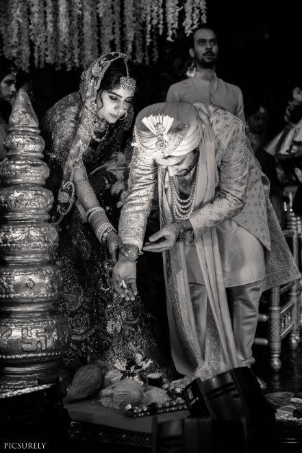 indian couple posing Mumbai wedding manish malhora lehenga | indian bridal red lehenga | indian couple black and white #wittyvows #indianwedding