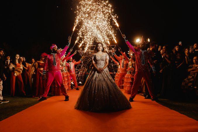 stunning bridal entry under fireworks