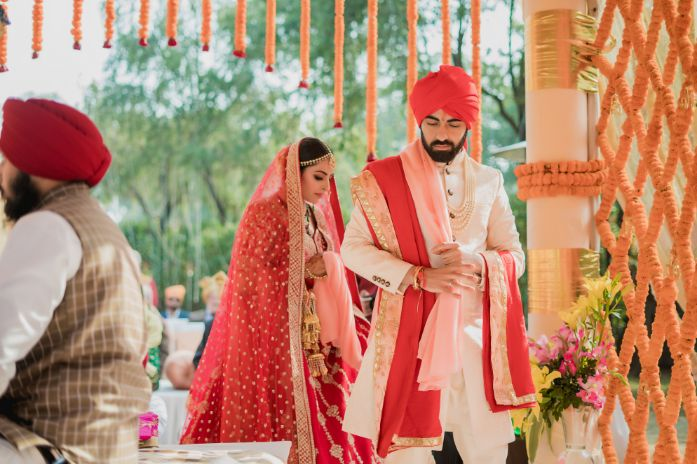 sath phera , bridal entry , anand karaj , indian wedding | indian groom | sikh groom | red pagri | grooms of india , indian grooms , anand karaj , red lehenga , red chooda , wittyvows , wedding , delhi wedding ,