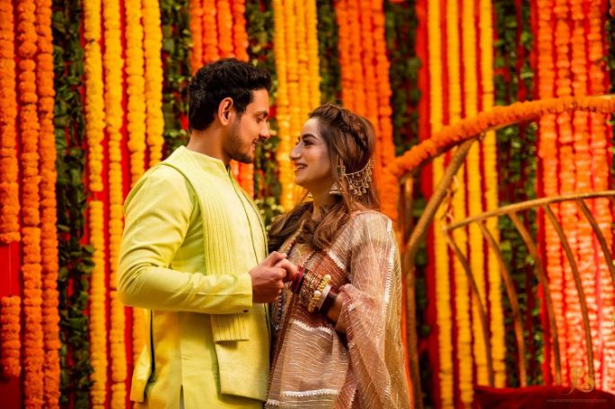 cute couple candid moments , haldi outfit , mehendi outfits , wittyvows , inidna wedding , indian bride , floral decor